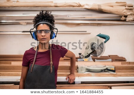 Confident female woodworker Stock photo © photography33