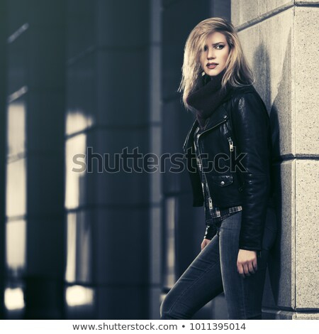 blonde in blue jeans stock photo © dolgachov