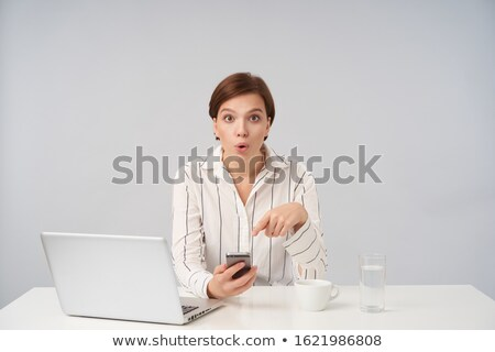 Businesswoman looking surprised while raising her hands Stock photo © wavebreak_media