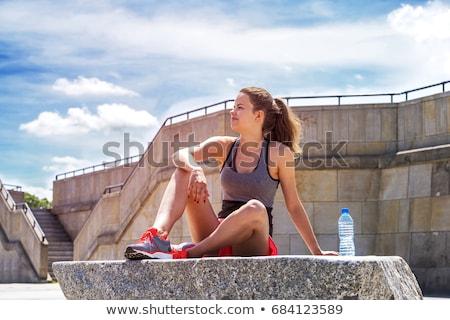 Uśmiechnięta kobieta butelki wody treningu szczęśliwy Zdjęcia stock © wavebreak_media
