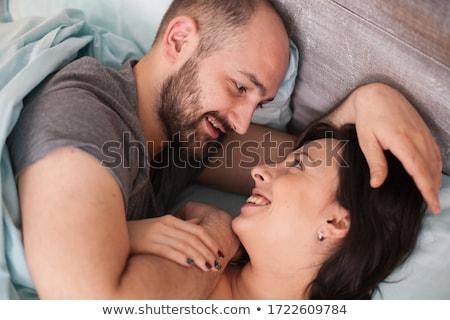 笑みを浮かべて · カップル · ベッド · 老夫婦 · 家 · 男 - ストックフォト © wavebreak_media