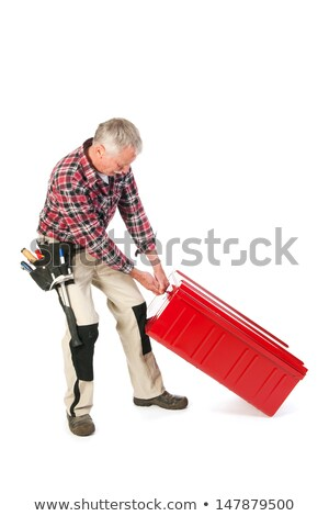 Manual worker with heavy toolkit Stock photo © ivonnewierink