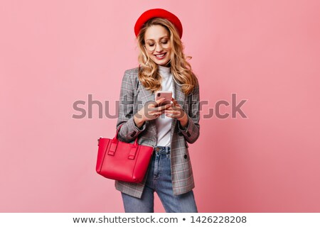 Stylish girl posing casually Stock photo © stockyimages
