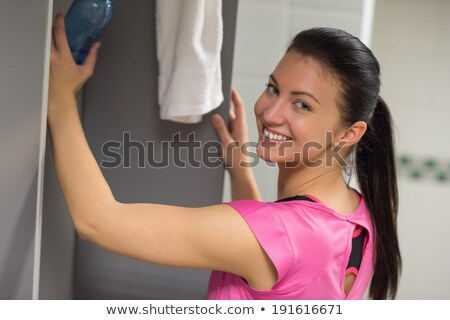woman putting bottle in locker at gym stock photo © candyboxphoto