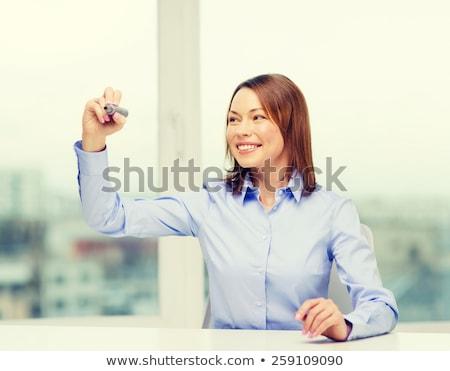 Bastante empresária escrita marcador branco terno Foto stock © wavebreak_media