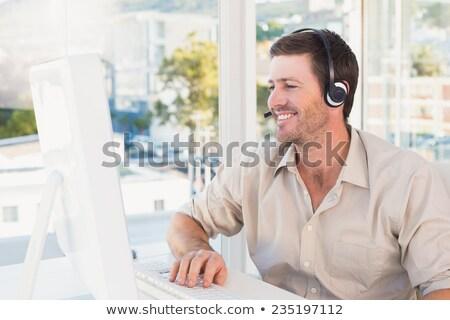 улыбаясь бизнесмен сидят столе видео чате Сток-фото © wavebreak_media