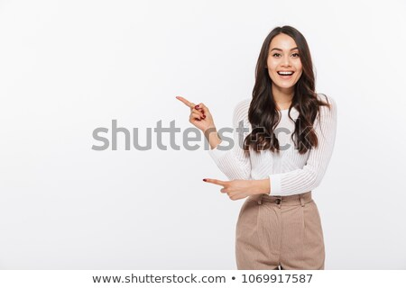 Portrait of a businesswoman pointing and smiling Stock photo © imagedb