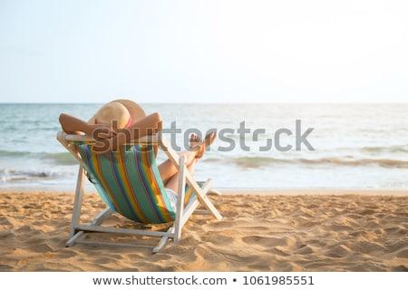 Dinlenmek güzel bir kadın rahatlatıcı plaj içmek seksi Stok fotoğraf © eleaner