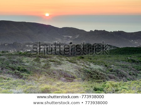 Sun Setting over Sweeney Ridge and the Pacific Ocean. Stock photo © yhelfman