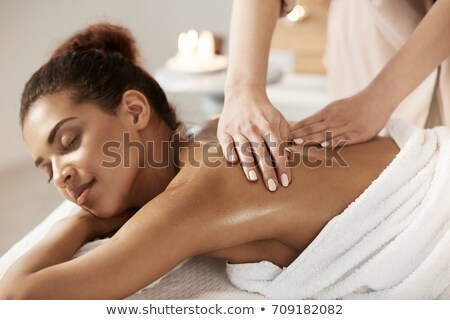 Lány masszázs nő mosolyog terápia szabadidő Stock fotó © IS2