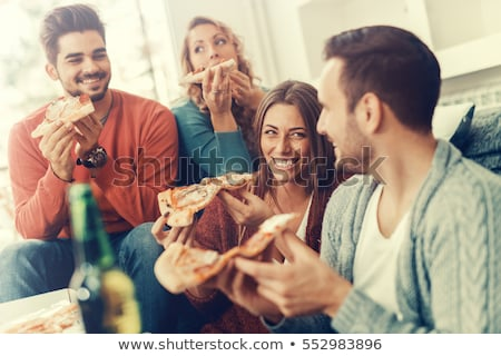 Stock foto: Happy Female Friends Eating Pizza At Home