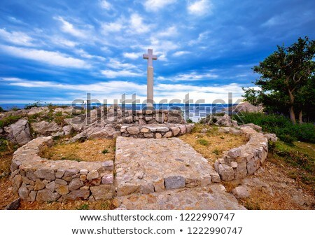 Island of Krk cross by the sea in Stara Baska village stock photo © xbrchx