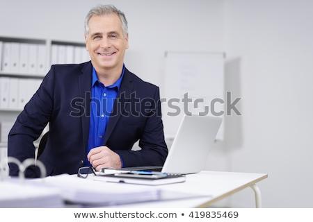 atraente · gerente · trabalhar · escritório · empresário · terno - foto stock © Minervastock