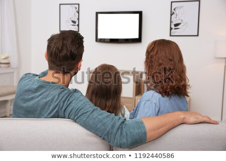 mother and daughter watching television stock photo © andreypopov