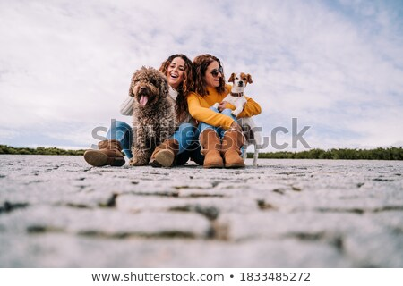 Two friends woman with terrier dog outside at the park Stock photo © Lopolo