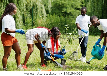 Volunteers Watering Plants from Can Digging Ground Stock photo © robuart