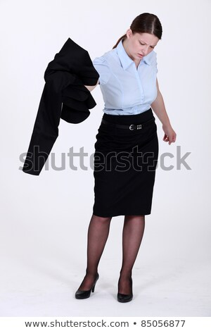 A businesswoman getting rid of her jacket. Stock photo © photography33