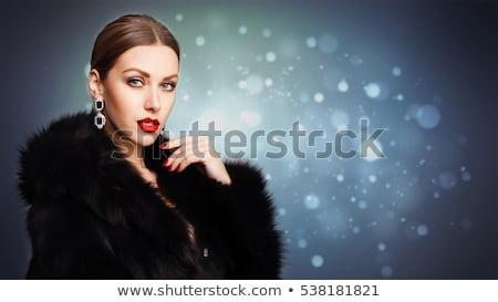 girl with fur and jewellery stock photo © carlodapino