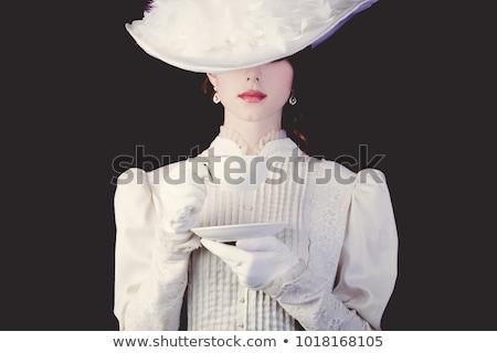 Vörös hajú nő fekete ruha izolált fehér lány divat Stock fotó © Elnur