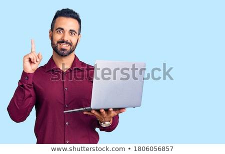 üzletember · ül · asztal · fiatal · laptop · szürke - stock fotó © feedough