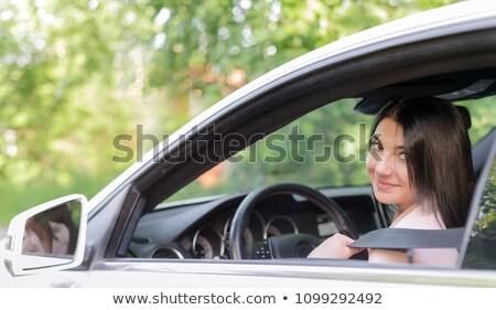 Beautiful young woman sitting on a street. Car lights behind her Stock photo © Nejron