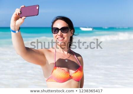 Mulher biquíni praia pessoas tecnologia Foto stock © dolgachov