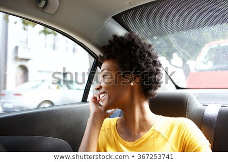 happy young woman sitting in car passenger seat and looking out stock photo © vlad_star