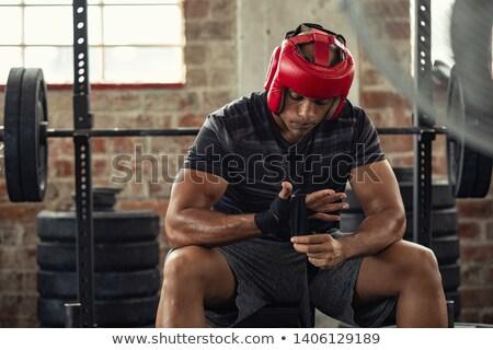 athletic man wearing boxing bandages stock photo © vlad_star