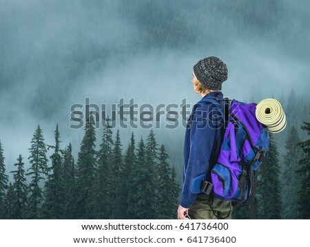 mountain travelyoung blond men with grey hat near the forest stock photo © wavebreak_media