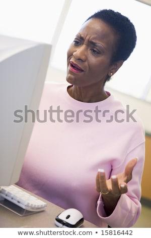 Dojrzały kobiet student frustracja komputera Zdjęcia stock © monkey_business