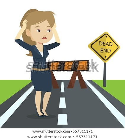 businesswoman looking at road sign dead end stock photo © rastudio
