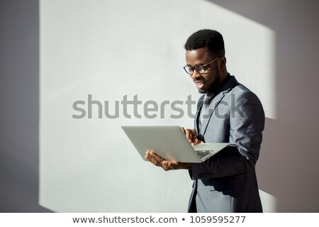african and caucasian businessmen working on laptop stock photo © studiostoks