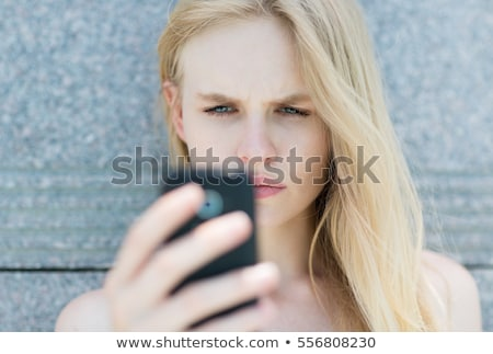 woman on telephone looking at bills stock photo © is2