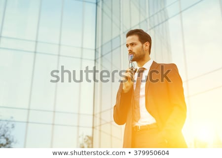 thoughtful young elegant man dreaming away Stock photo © feedough