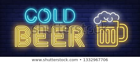 cold beer neon advertising sign stock photo © balasoiu