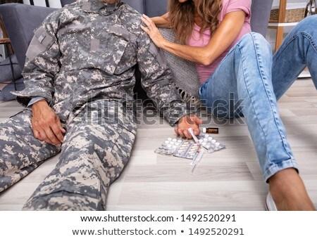 Mozgássérült veterán ül padló injekciós tű tabletták Stock fotó © AndreyPopov
