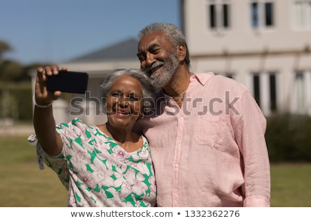 front view of active senior couple taking selfie with mobile phone on the beach Stock photo © wavebreak_media