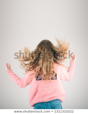 Back view of girl jumping in the air over plain background Stock photo © przemekklos