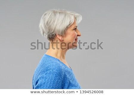 profile of smiling senior woman over blue Stock photo © dolgachov