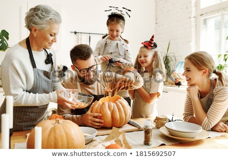 family carving pumpkins together stock photo © photography33