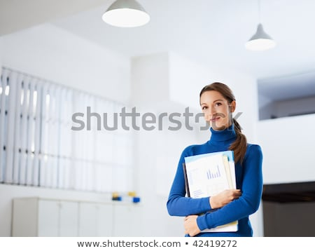 business woman holding reports and looking to the camera Stock photo © adam121