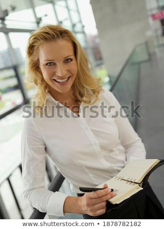 деловая женщина дневнике улыбаясь бизнеса женщину телефон Сток-фото © photography33