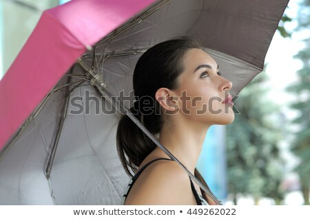 Girls under a purple umbrella Stock photo © photography33