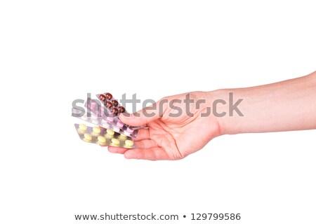 Male Hand Giving Medical Pills In Blasters Foto d'archivio © Len44ik