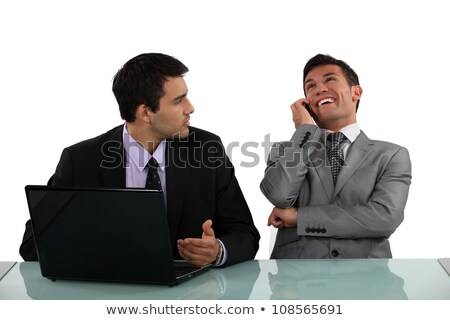 Businessman getting annoyed at loud colleague Stock photo © photography33