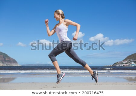 Attractive blond woman running in the sea Stock photo © Nejron