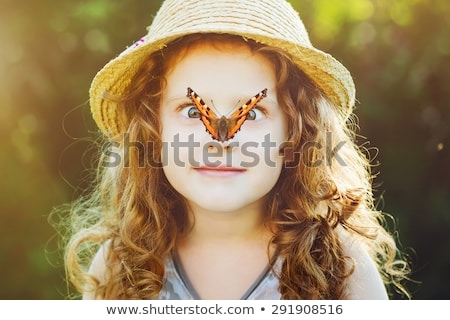 portrait of a girl with a butterfly on her head Stock photo © mizar_21984