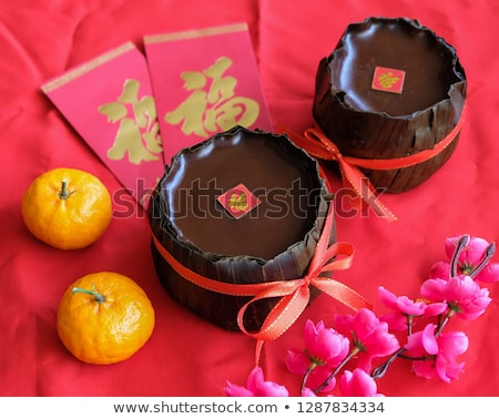 chinese new year rice cake mandarin oranges and red packets stock photo © dezign56