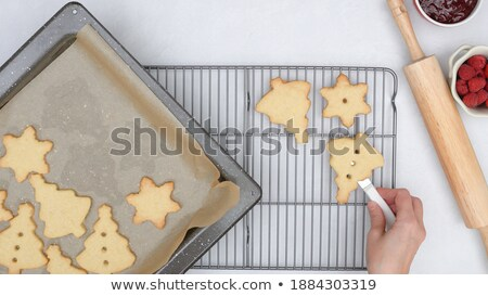 Pastry cutter and baking sheet on cooling rack Stock photo © wavebreak_media