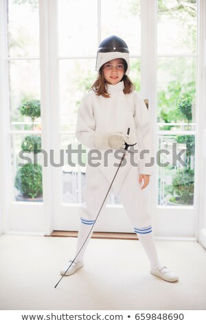 girl wearing fencing gear in living room stock photo © is2